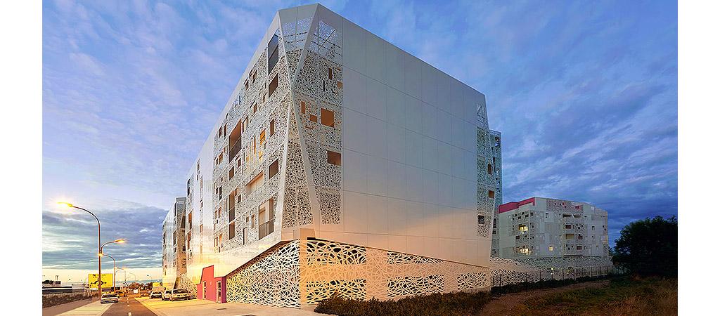 facade nuit logements collectifs